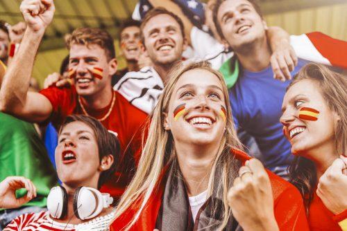 Geschminkte Fussballfans im Stadion Fotolia_109127389